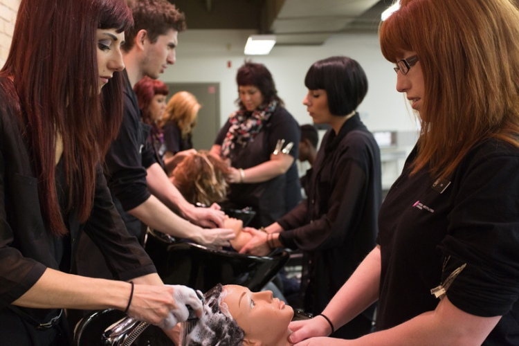 Cosmetology students working on mannequin heads